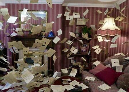 Dursley's living room covered in letters.