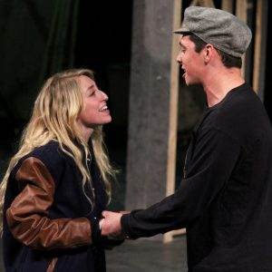 a female and male theatre student rehearse a song from the show